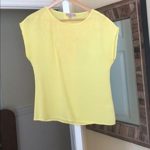 Bright yellow cap sleeve blouse